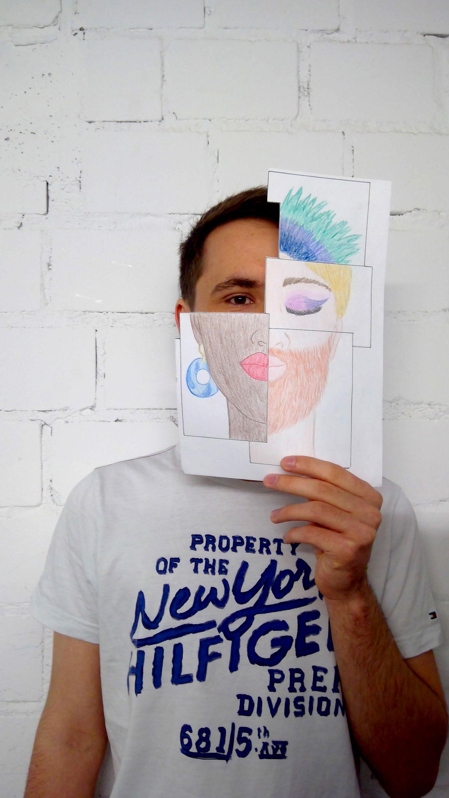 Ein Mensch hält Zeichnung von verschiedenen Gesichtern vor sein eigenens Gesicht.